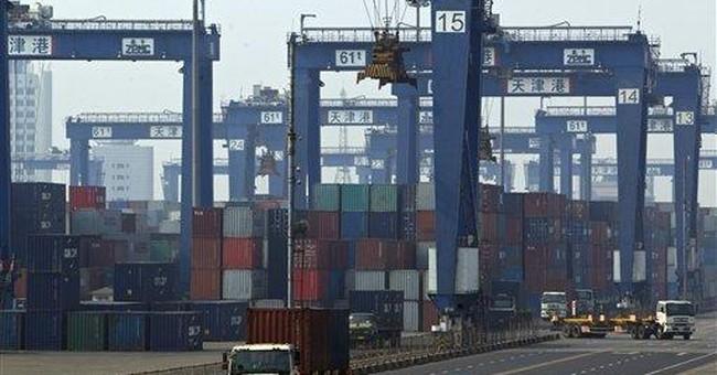 China reports rare trade deficit as imports jump