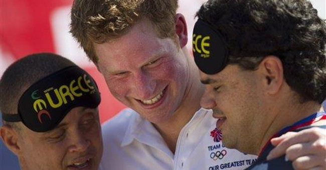 Prince Harry leads race, plays rugby in Rio