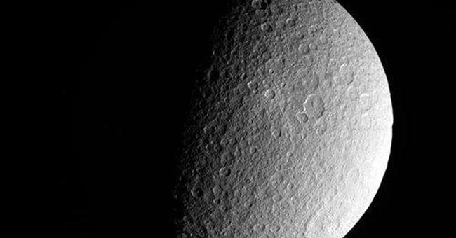 Cassini spacecraft glimpses new views of moon Rhea