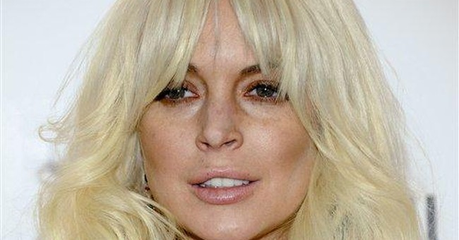 Lohan tweets it's a 'lie' that her car grazed man