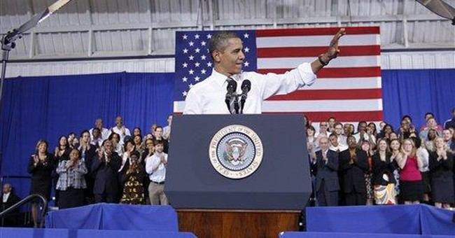 Obama defends energy record