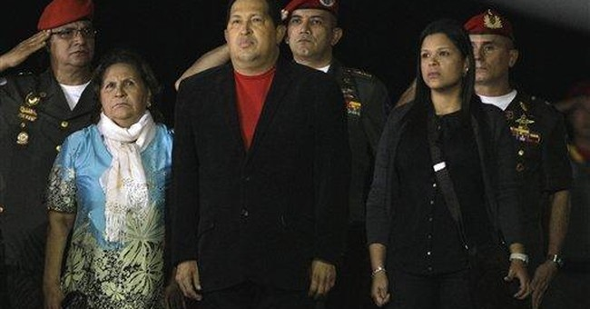 Chavez back in Venezuela after cancer surgery