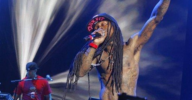 Lil Wayne told to cut grass of La. mansion
