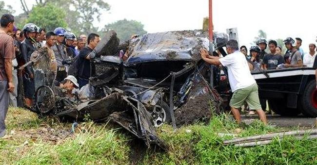 Train hits van at Indonesian crossing; 11 dead