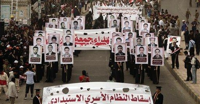 Yemen protesters demand ex-president face trial
