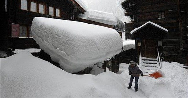 Heavy snow slows road, rail travel in Alps