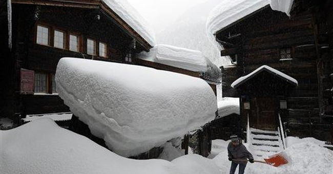 Heavy snow slows road, rail travel in Alps