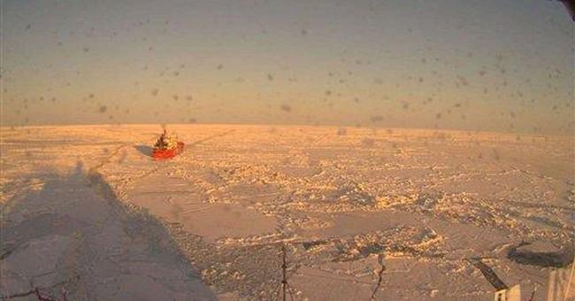 Icebreaker helping fuel ship reach iced-in AK city