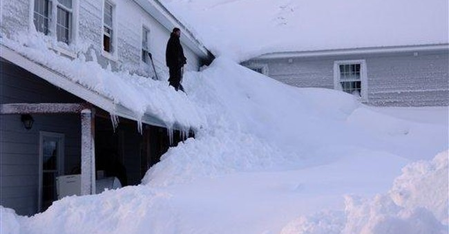 Alaska town tries to dig out from huge snow dump