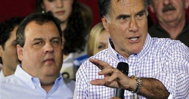 Romney defends business record in face of attacks