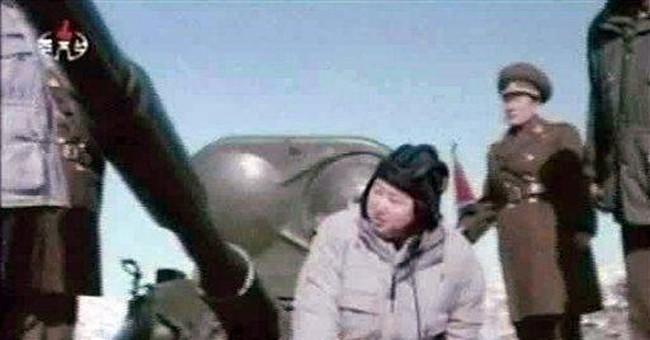 NKorea to pardon convicts; generals back young Kim