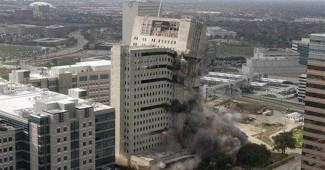 Demolition crews bring down Houston skyscraper