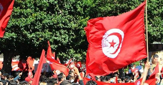 Tunisians call for civil state on national day