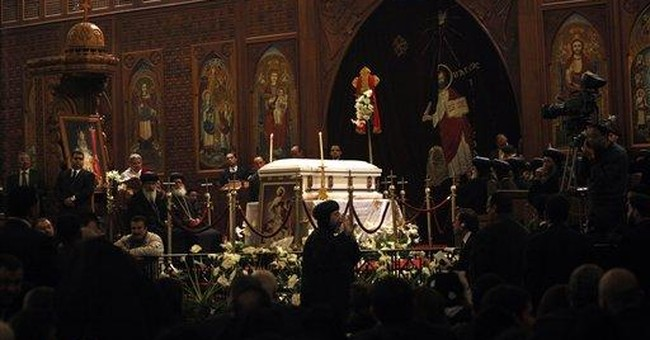Egypt's Coptic pope buried, Christians anxious