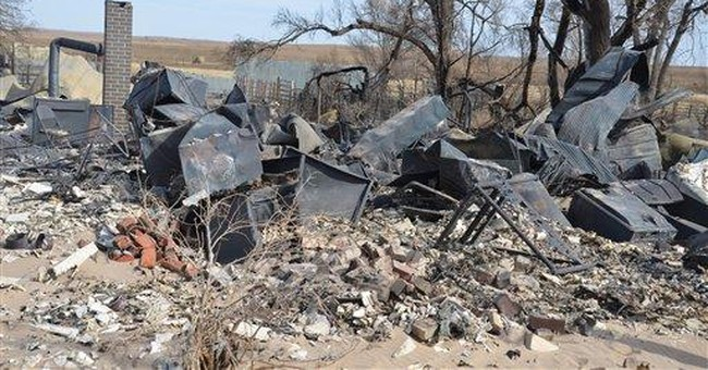 Colorado assesses wildfire damage, braces for more