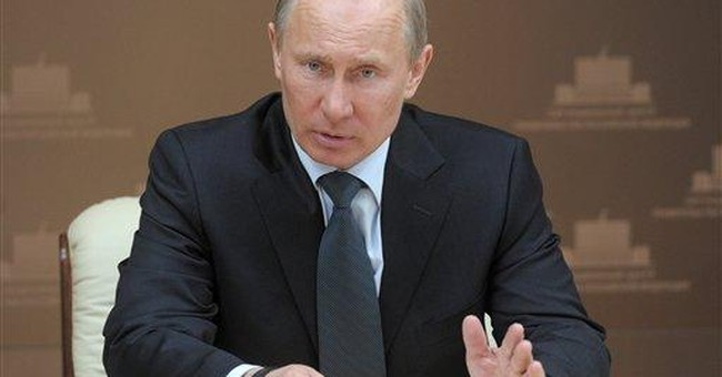 NATO says Putin unlikely to attend Chicago summit