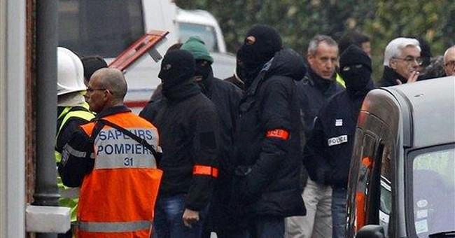 French police press besieged gunman to surrender