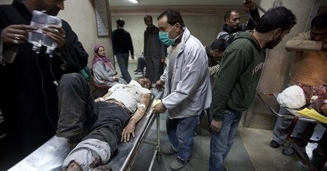 Police say car blast kills 1, wounds 23 in Kashmir
