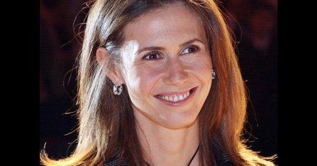 EU slaps sanctions on Assad's wife, relatives