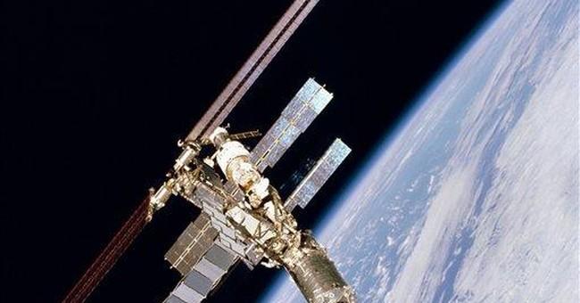 Space junk misses station astronauts