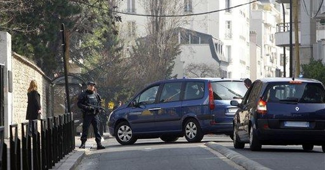 French gunman's brother charged, denies role