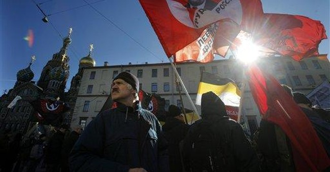 Police detain protesters in Moscow, St. Petersburg