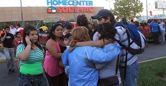 Chile defends response to quake, threat of tsunami