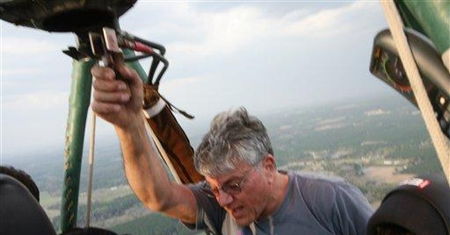 Report: Balloon pilot tried to climb over storm