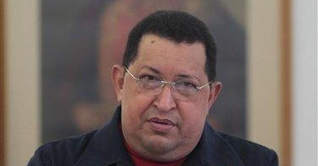Chavez back in Venezuela after 1st radiation round