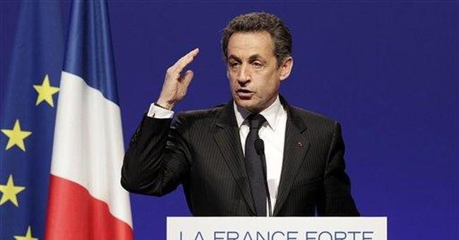Sarkozy embraces small good news for the economy