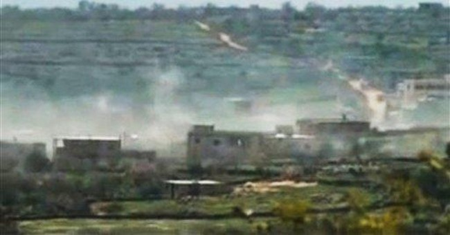 Destruction as Syrian forces take opposition town