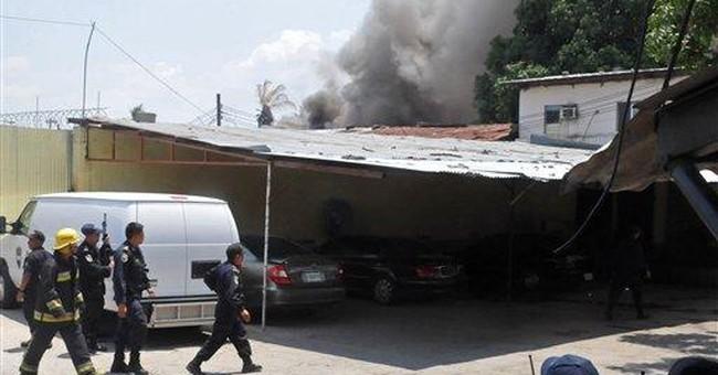 13 dead in Honduran prison fire amid inmate riot