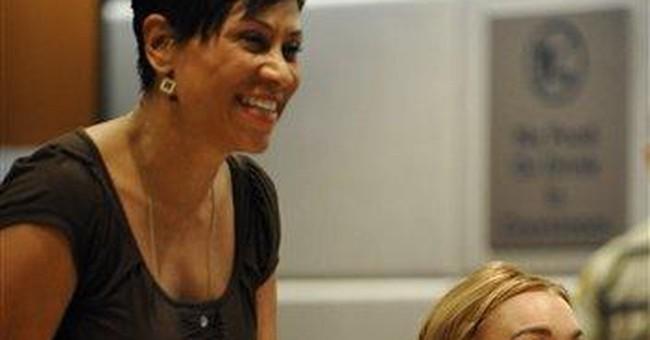 Judge ends Lohan's probation, gives back freedom