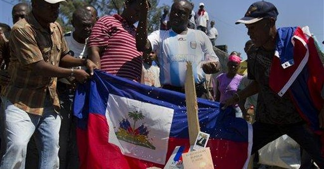 Fugitive foe of Aristide backs ex-Haiti president
