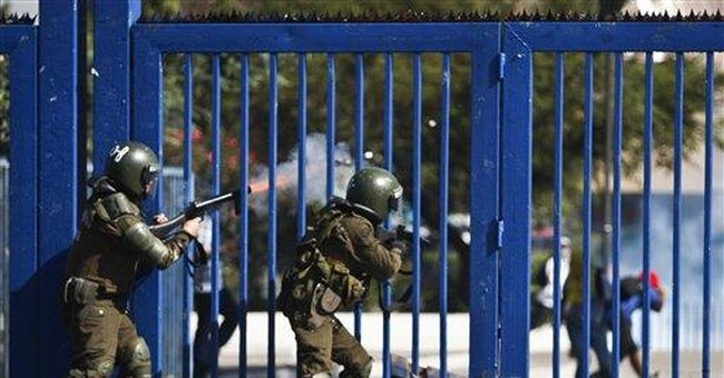 Chilean youths, police clash on 'combatant day'