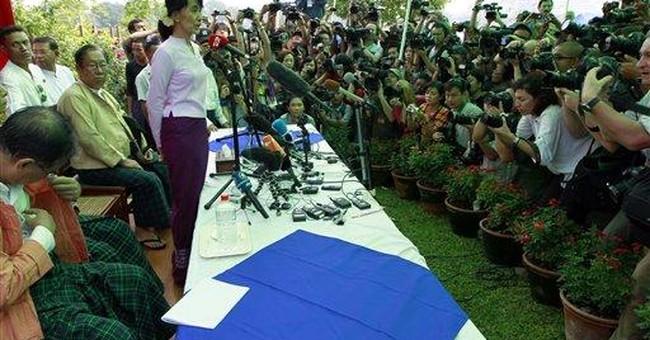 Suu Kyi committed to win, says Myanmar vote unfair