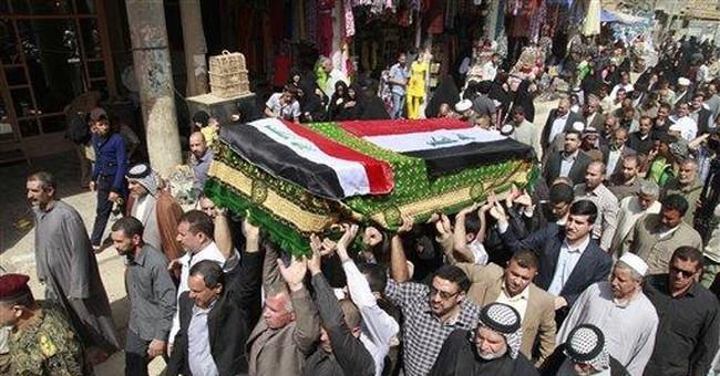 Iraqi-American woman slain in US is buried in Iraq