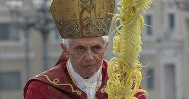 Pope, just back from trip, celebrates Palm Sunday