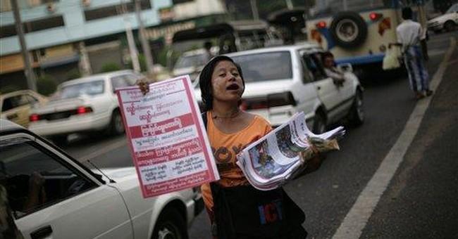 Myanmar's Suu Kyi hopes victory is dawn of new era