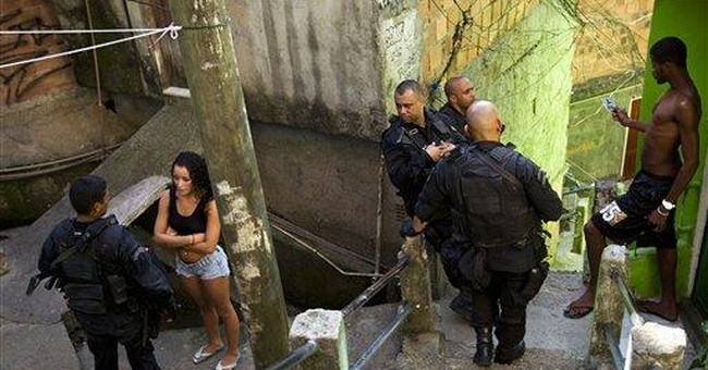Brazil: Officer latest slaying victim in Rio slum