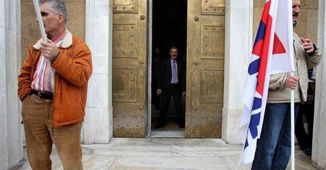 Greek PM sees economy starting to grow in 2 years