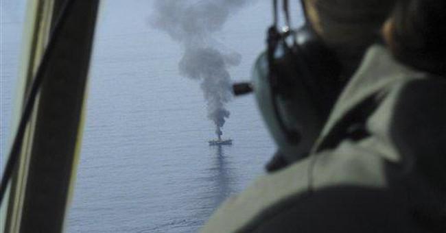 C. Guard guns sink ship adrift since Japan tsunami