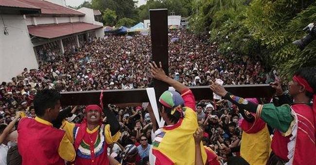 Filipino Good Friday devotees nailed to crosses