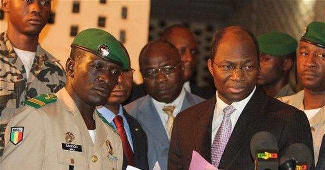 APNewsBreak: Mali's coup leader to return power