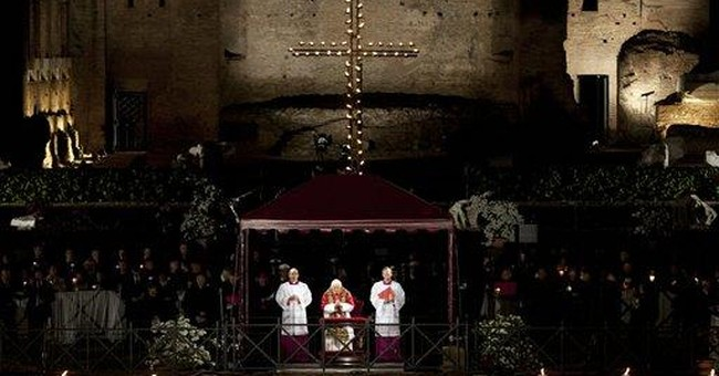 Pope takes cross at end of Colosseum procession