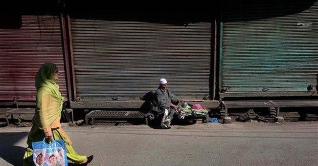 Kashmir on strike after US sentences accused agent
