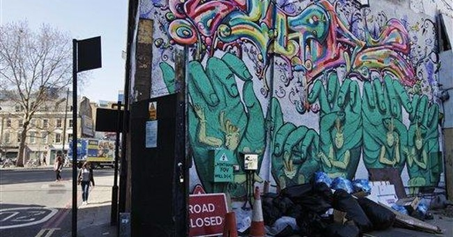 In tough times, British artists hit the streets