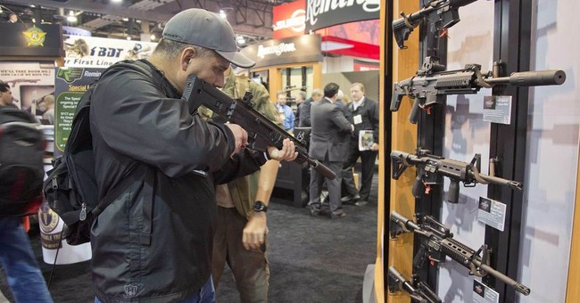 Gun group chief says industry didn't cause Newtown