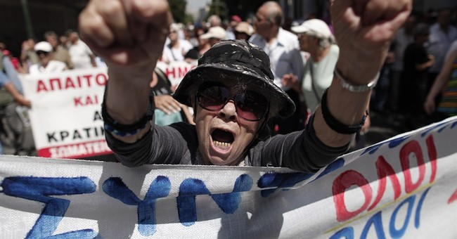 EU rejects IMF criticism on handling Greek crisis