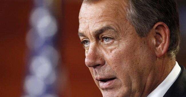 Boehner protests Obama veto threats on budget
